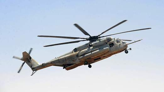 A US Marine CH-53 helicopter flies over