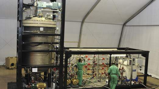 Handout photo shows specialized technicians work on the Field Deployable Hydrolysis System