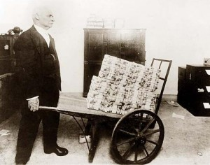 Wheelbarrow-of-Money-300x236