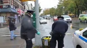 NYPD caught dumping gloves, masks from Ebola site into street garbage can (VIDEO)