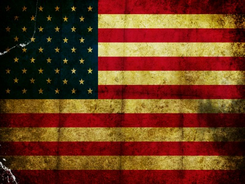 Scratched grunge and burned flag of America