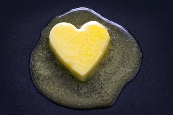 a heart shaped butter pat melting on a non-stick surface