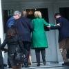 Hillary-being-helped-up-the-stairs