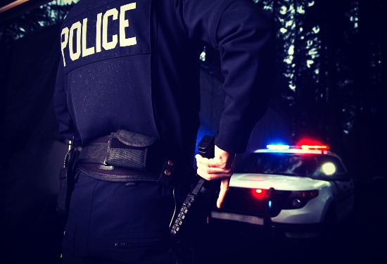 police-officer-cop-grabbing-gun