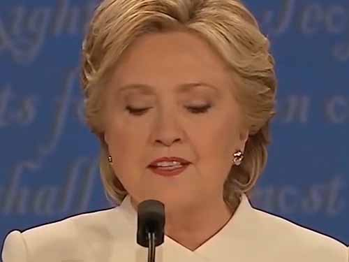 hillary-looking-down-at-podium