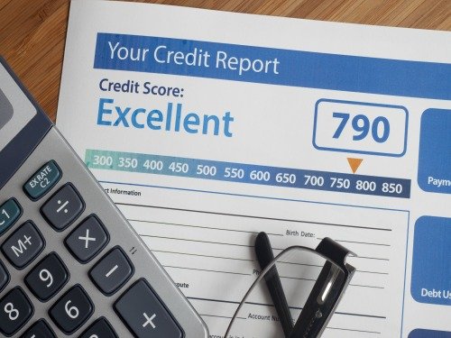 Credit report with score on a desk