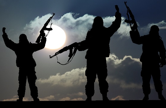 Silhouette of military soldier or officer with weapons at sunset. shot, holding gun, colorful sky,