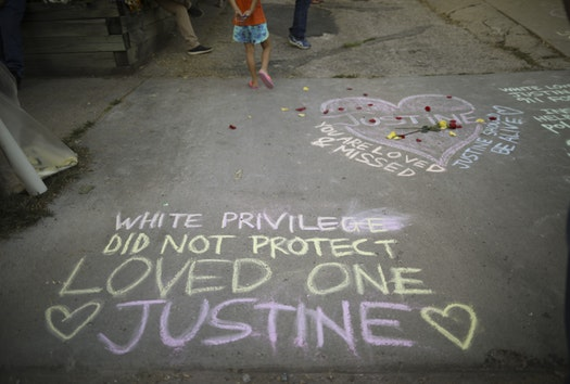 Chalk memorials cover the street and sidewalks near the Minneapolis home of Justine Damond, who was shot and killed by police after calling for help.