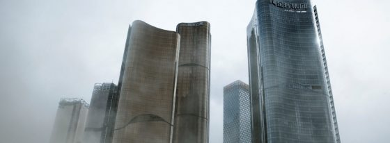 A man walks through a cloud of dust whipped up by wind at the construction site near newly erected office skyscrapers in Beijing
