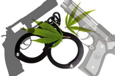 Marijuana leaves and handcuffs isolated on white background illegal drug.