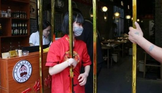Image result for Chinese Restaurant Offers Free Food To Diners Who Can Fit Through