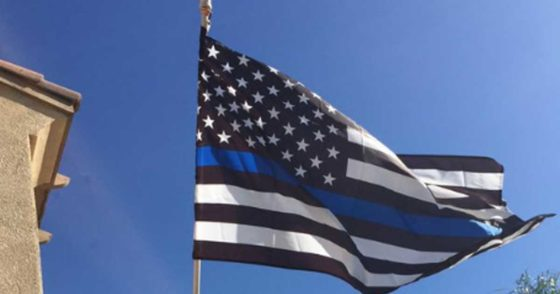 Cops Arrest Protesters for Desecrating Thin Blue Line Flags